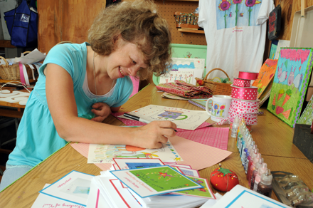 Young woman with disability at work in her own design home business.